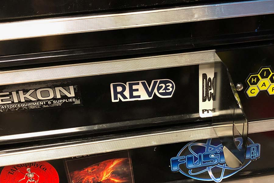 REV23 promotional items in the store now